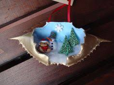 painted crab shells ornaments by crabbiestcreations on etsy