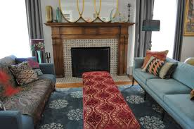 fireplace area rug with mixed pattern bench and curtains also