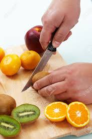 cutting different fruits with kitchen knife stock photo picture