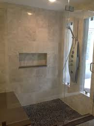 river rock shower floor with complex wall tiles this is what we