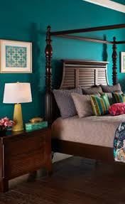 best 25 teal master bedroom ideas on pinterest teal spare layers of color and texture are found in the bedding bringing bright pops of color for volume and interest
