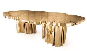 boca do lobo creates fortuna dining table that shines like gold