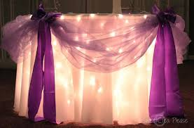 how to use tulle to decorate a table goddess of eats decorating a cake table with lights and tulle a
