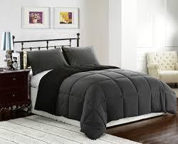 modern bedroom with grey reversible down alternative comforter set