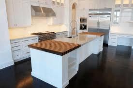 brown striped wooden countertop plain white kitchen backsplash