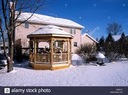 gazebo on backyard of house besedka rest area snow roof tranquil