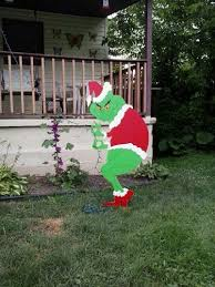 grinch stealing christmas lights grinch christmas creeping grinch stealing lights outdoor wood yard