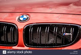 luxury car logos and names bmw m4 touring sport car front detail red color and brand logo