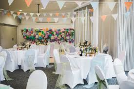 wedding venue backdrop a handmade vintage inspired wedding with colourful paper tissue