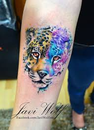 colored jaguar face tattoo on forearm by javi wolf
