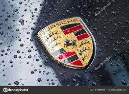porsche logo porsche logo close up on a black car with rain drops u2013 stock