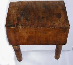 an early 20th century maple butcher block on four turned legs for