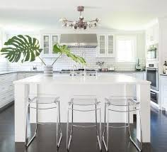 stunning monochromatic white kitchen features three clear acrylic