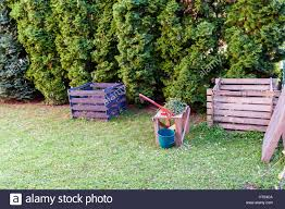 compost cutter and composting frames in a backyard stock photo