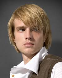 longer hairstyle for men with clean lines around the ears and
