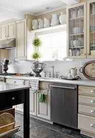 creamy kitchen cabinets and walls paired with white marble