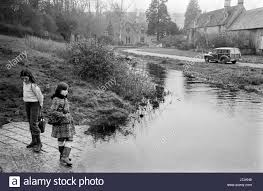 1970s britain uk river running through village country life
