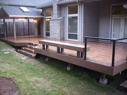 timbertech deck with cable railing and lights deck masters llc