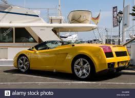 yellow lamborghini gallardo a yellow lamborghini gallardo cabriolet parked in front a luxury