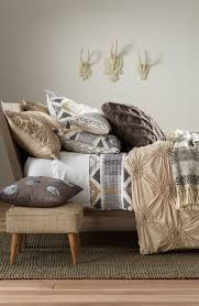 geometric ikat patterns paired with a shabby chic comforter define