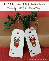 diy reindeer and snowman thumbprint tags a gift in itself