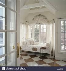 coronet with white voile drapes on windows behind antique wrought