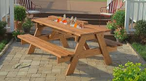 diy outdoor wooden picnic table with cooler and benches in the