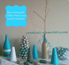 christmas decorating with glittered pinecones and ornaments