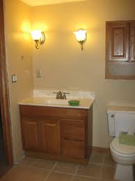 half bathroom designs resplendent wooden single sink vanity bath with double wall light