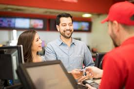 couple buying tickets at the movies pictures images and stock