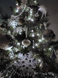 tree with white and silver decorations white