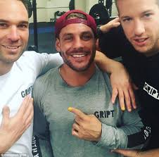three personal trainers at gript gym in australia posted a shot of themselves with yellow