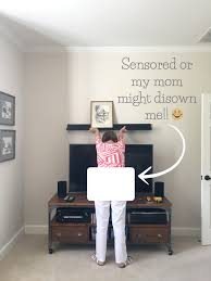 What Height To Hang A Picture How To Decorate Above The Tv A Simple Solution Driven By Decor