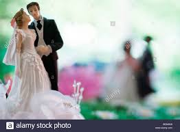 and groom figurines plastic and groom figurines up stock photo royalty