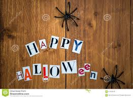 happy halloween letters cut out from the magazines and black spi