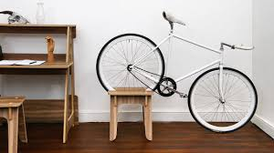 this sofa bookcase and desk all double as places to store your bike