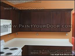 How To Faux Paint Kitchen Cabinets Painting And Refinishing Kitchen Cabinets To Look Like Wood Pictures