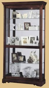 cherry curio cabinets cheap howard miller dublin traditional cherry wood collectors curio