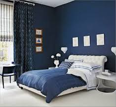 modern blue interior with matching blue curtains and king size