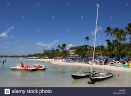 the beach of boca chica dominican republic a sail boat can be on