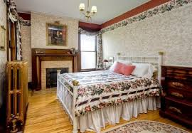 Queen Anne Interior Design by Classic Bedroom With Fireplace Design In Queen Anne Victorian