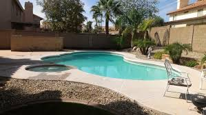 simple rectangular blue swimming pool ideas with stone side