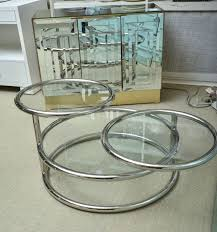 mid century chrome and glass swivel three tiered coffee table at