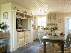cream country kitchen with black aga martin moore kitchens