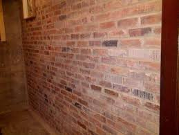 restored brick wall in basement shower room how do i seal it