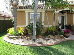 beige exterior wall color for tropical landscape ideas with
