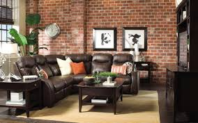 small wall clocks for living room with brown leather couch