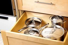 How To Organize A Kitchen Cabinets How To Organize Pots And Pans Reader U0027s Digest