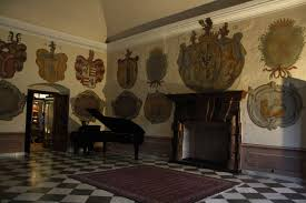 file coat of arms on wall piano and fireplace in kamenný sál