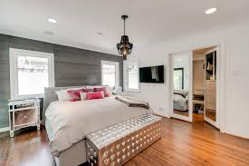 modern bedroom with grey accent wallpaper and using mini black